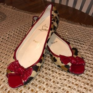 CHRISTIAN LOUBOUTIN- Leopard flats with red bow.
